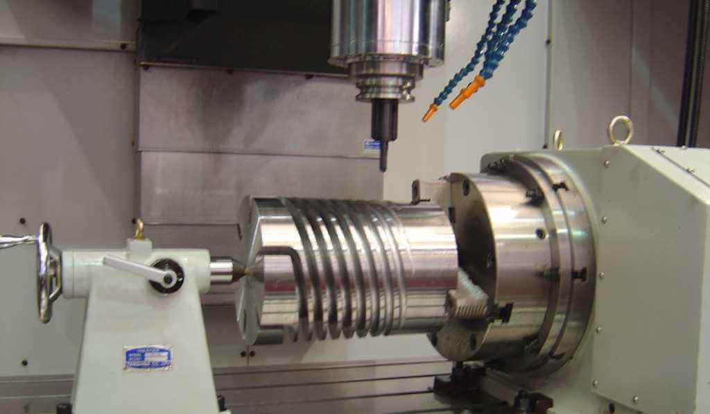 What is a 4-axis CNC machining center