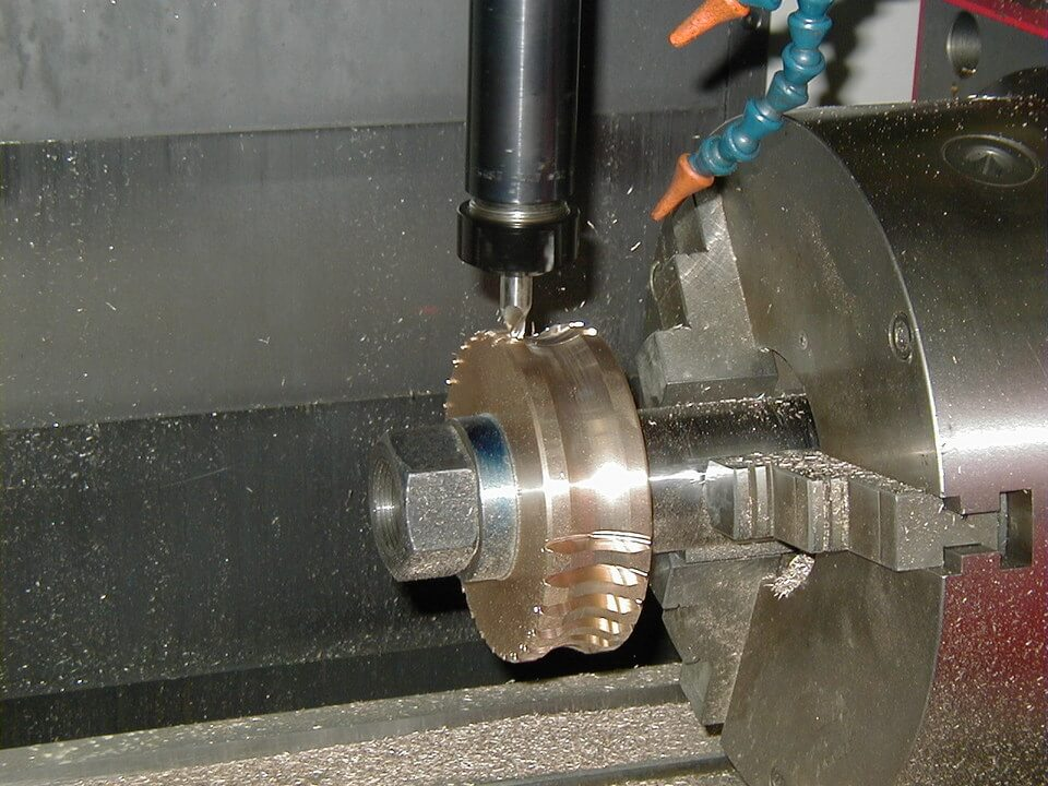 What is a 4-axis CNC machining center?