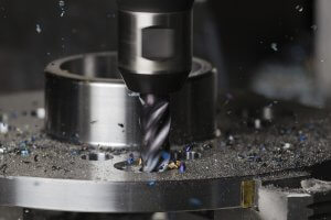 What is the difference between CNC lathes and CNC milling machines?